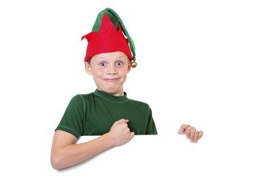 happy elf holding sign