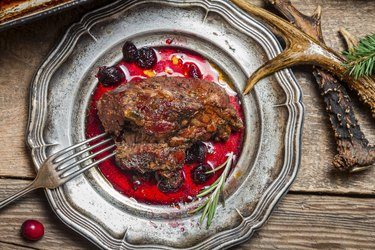 Venison served with cranberry sauce