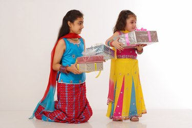 Two girls holding gifts, children