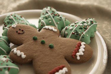 Gingerbread man and Christmas cookies on plate, elevated view