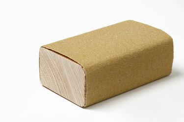 Sanding block wrapped with sanding paper