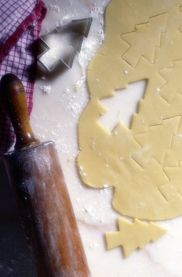 Dough, rolling pin, and christmas cookies