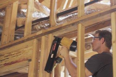 Carpenter using nail gun