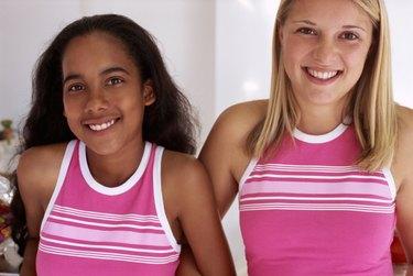 Two teenage girls wearing the same fashion
