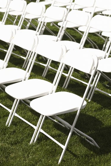 White folding chairs in rows