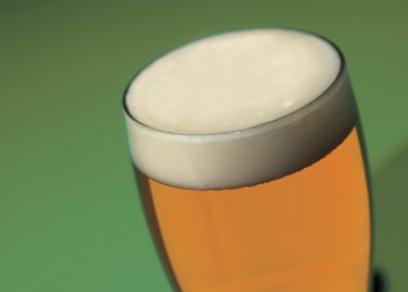 close-up of head of a beer in a glass
