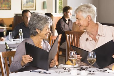 Couple reading menus in restaurant