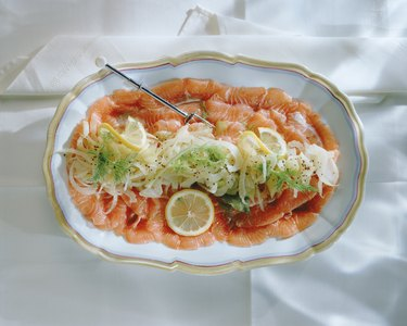 Salmon with vegetable salad on plate, close-up
