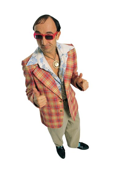 Cheesy guy in leisure suit giving thumbs up