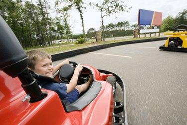 Boy riding go kart