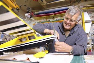 Senior man working on model airplane