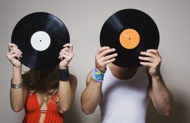 People holding vinyl records