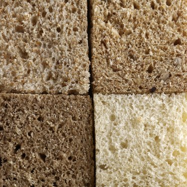 Four slices of bread of various colors and textures