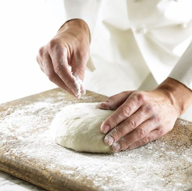 Chef rolling out dough