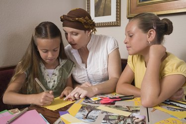 Mother and daughters scrapbooking