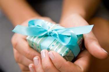 Hands holding Christmas present