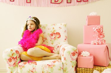 Girl sitting alone at birthday party