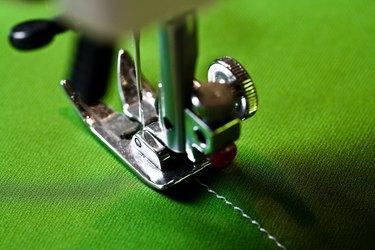 Sewing machine on green fabric