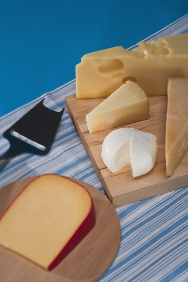 assorted cheese on cutting boards