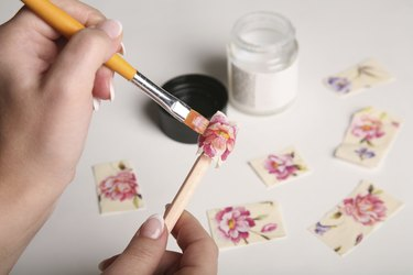 Decoupage of wooden bead with roses and peonies