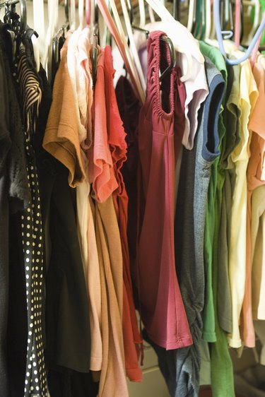 Clothes hanging in woman's closet