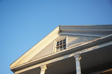 Gable roof over porch with window in pediment