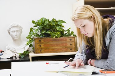 Woman drawing on a sheet