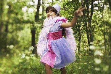 Running pre-teen girl wearing princess costume