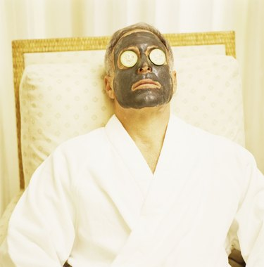 Man with spa mud mask