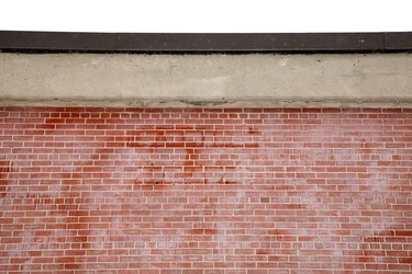 Close-up of brick wall with concrete entablature