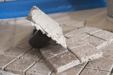 Grout on trowel by tiles