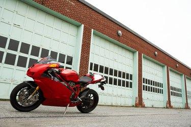 Motorcycle in front of garage doors