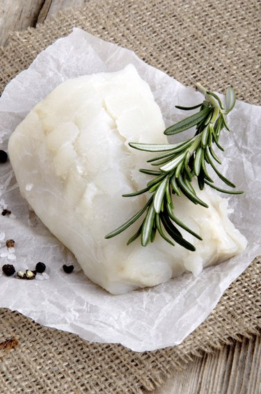 cod filled with rosemary on kitchen paper