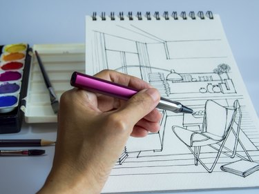 Designer's hand drawing interior perspective view of modern living room