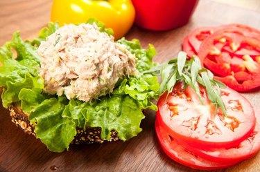 Tuna fish sandwich on multigrain bread with lettuce and tomato