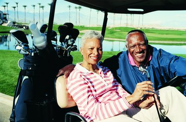 Portrait of a Senior Couple Sitting in a Golf Cart