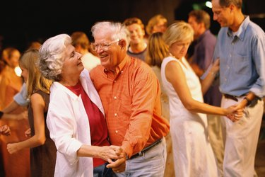 Man and woman dancing among a group of people