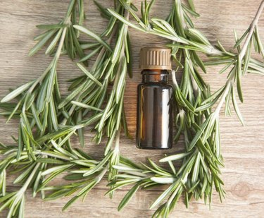 aromatic oil of rosemary on a wooden table