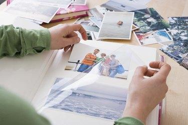 Woman organizing photo album
