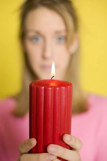 Woman holding lit candle