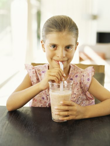 Portrait of a girl drinking a smoothie
