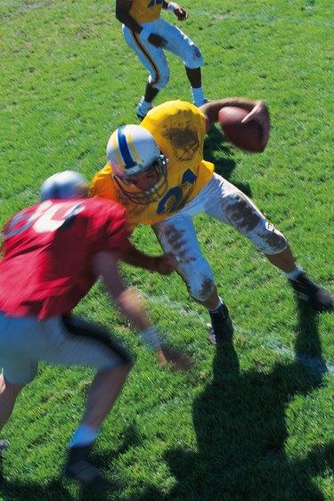 Runner meets tackler in football game