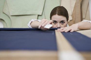 Woman measuring fabric