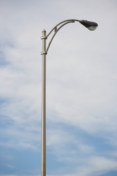 Light pole and cirrostratus clouds