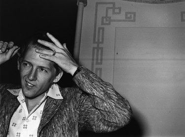 Controversial rocker Jerry Lee Lewis combing his hair in London.    (Photo by Evening Standard/Getty Images)