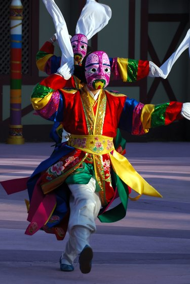Dancer with pink mask