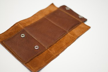 Sew outside and inside wallet together.
