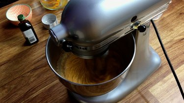 Mixing pumpkin pie filling in a stand mixer.
