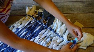 Finishing fringed edges for rag rug.