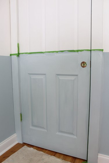 Paint the remaining areas of the interior door.